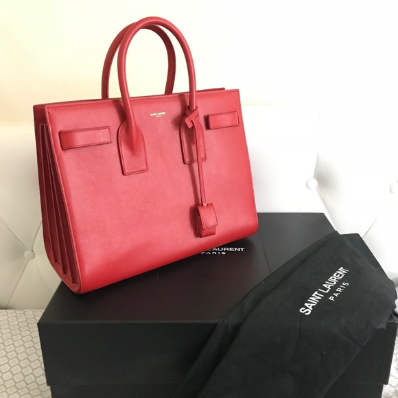 YSL Sac De Jour in RED! Never used. Yves Saint Laurent.  M 5a96c45450687c5bce4bc7a1. M 5a96c4548df4705c74fb211c.  M 5a96c45431a376e5e5a88143 0f330049c3e03